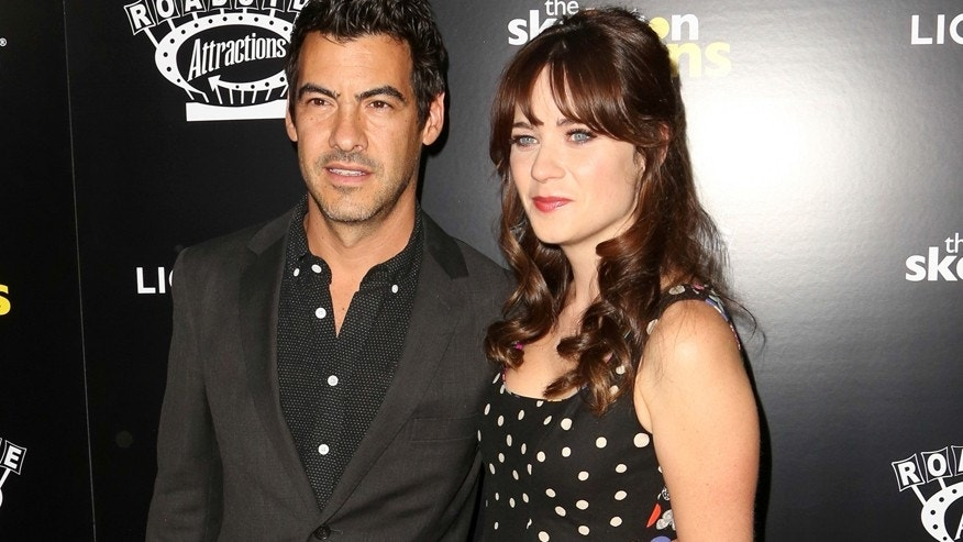 "In this Sept. 10, 2014 file photo, Jacob Pechenik, left, and Zooey Deschanel  attend ""The Skeleton Twins,"" premiere at ArcLight Theatre in Los Angeles."