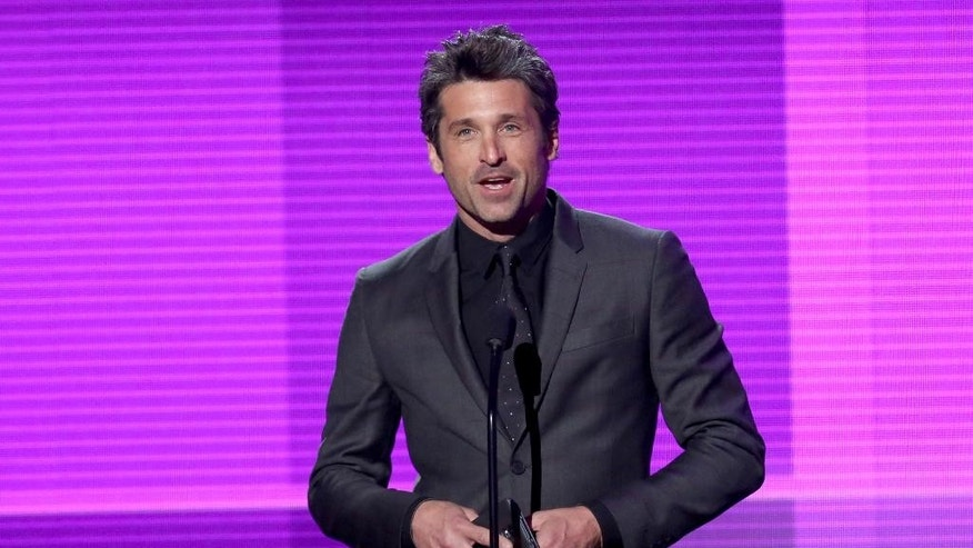 "FILE- In this Nov. 23, 2014 file photo, Patrick Dempsey presents the award for pop/rock band, duo or group on stage at the 42nd annual American Music Awards in Los Angeles. In the Thursday, April 23, 2015, episode of ""Grey's Anatomy"" Dempsey made a surprise departure from the series, when his character Derek ""McDreamy"" Shepherd died from injuries suffered when he was blindsided by a truck. ABC President Paul Lee was asked Tuesday, Aug. 4, about the decision to kill off Dempsey's character, Derek ""McDreamy"" Shepherd  from the show. The question was asked at a bi-annual press conference for TV critics. Lee went on to say that ""It was a difficult decision. Patrick obviously has lots of interests outside. He's very big in motosport. Shonda (Rhimes) decided that was the way to go."" (Photo by Matt Sayles/Invision/AP, File)"