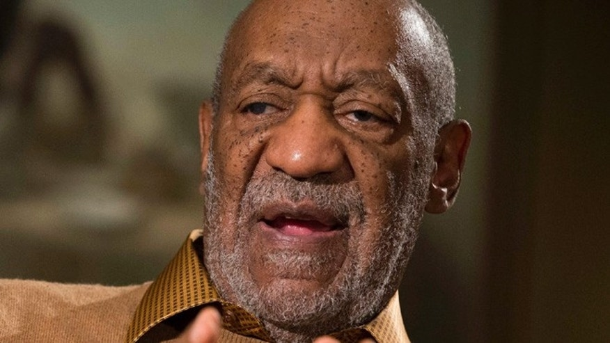 "Nov. 6, 2014:Bill Cosby gestures during an interview about the upcoming exhibit, ""Conversations: African and African-American Artworks in Dialogue, "" at the Smithsonian's National Museum of African Art, in Washington."