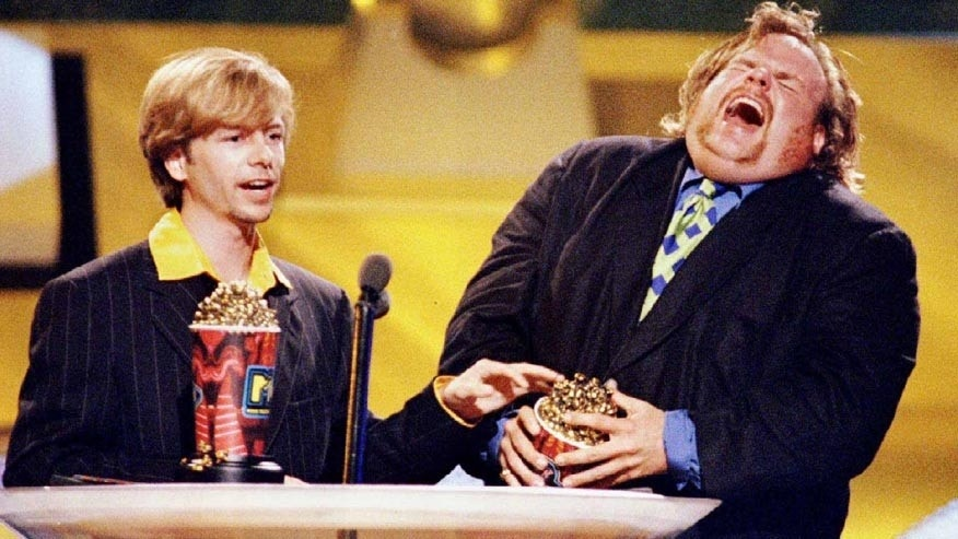 "FILE PHOTO 9JUN96 - Actors David Spade (L) and Chris Farley accept the award for Best On-Screen Duo for their roles in the film ""Tommy Boy"" at the 1996 MTV Movie Awards which were taped at Disney Studios in Burbank, June 9, 1996. Farley was found dead in Chicago December 18, the cause of his death was not immediately known.FARLEY - RTR9PAL"