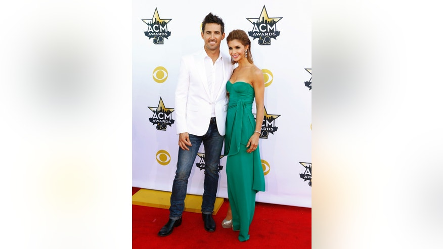 Singer Jake Owen and his wife, Lacey Buchanan, arrive at the 50th Annual Academy of Country Music Awards in Arlington, Texas April 19, 2015. REUTERS