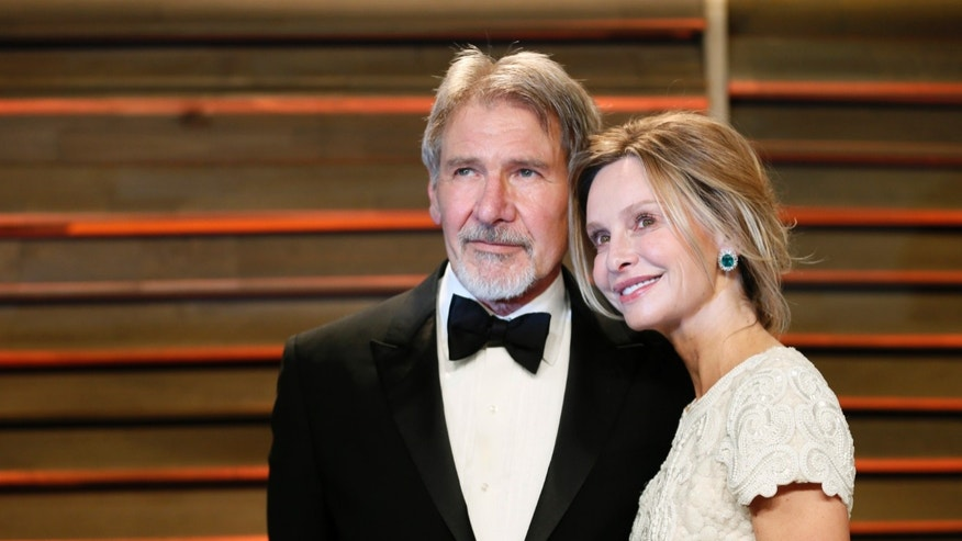 Actor Harrison Ford and his wife Calista Flockhart arrive at the 2014 Vanity Fair Oscars Party in West Hollywood, California March 2, 2014. REUTERS/Danny Moloshok (UNITED STATES  - Tags: ENTERTAINMENT)(OSCARS-PARTIES) - RTR3FYET
