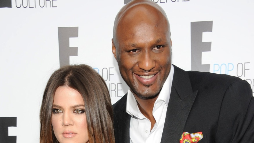 """FILE - In this April 30, 2012 file photo, Khloe Kardashian Odom and Lamar Odom from the show """"Keeping Up With The Kardashians"""" attend an E! Network upfront event at Gotham Hall in New York. After months of speculation, Kardashian is ending her four-year marriage to Odom. The Reality TV star filed for divorce Friday, Dec. 13, 2013, in Los Angeles County Superior Court, citing irreconcilable differences. (AP Photo/Evan Agostini, File)"""