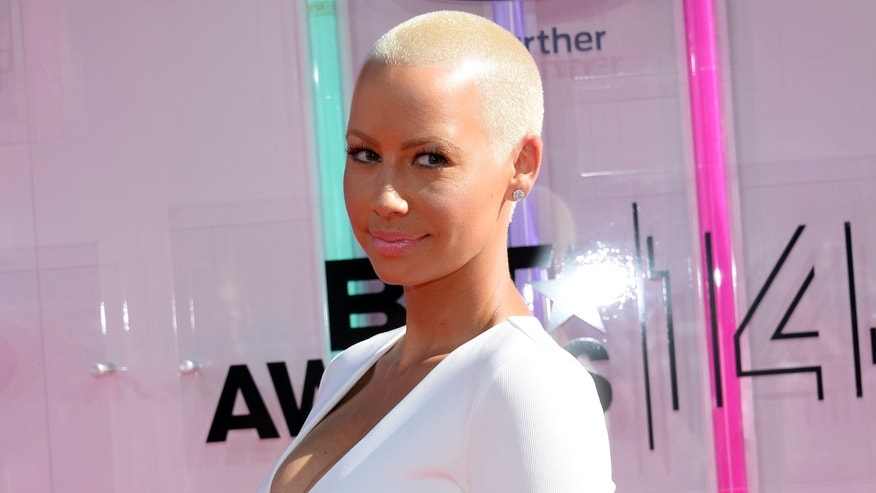 Amber Rose arrives at the 2014 BET Awards in Los Angeles, California June 29, 2014.  REUTERS/Kevork Djansezian  (UNITED STATES-Tags: ENTERTAINMENT)(BETAWARDS-ARRIVALS) - RTR3WCQY