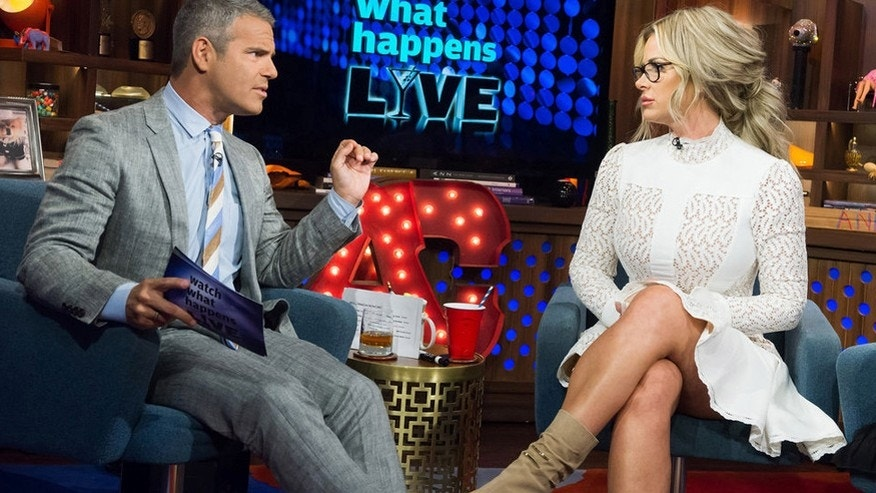 """Watch What Happens Live"" host Andy Cohen (left) interviews Kim Zolciak-Biermann."