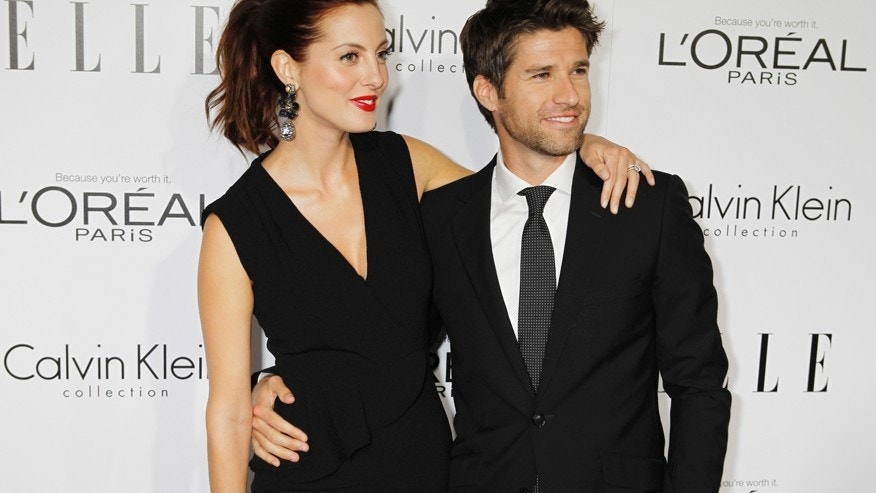 Actress Eva Amurri and husband Kyle Martino arrive as guests at the 19th Annual ELLE Women in Hollywood dinner in Beverly Hills, Callifornia October 15, 2012.