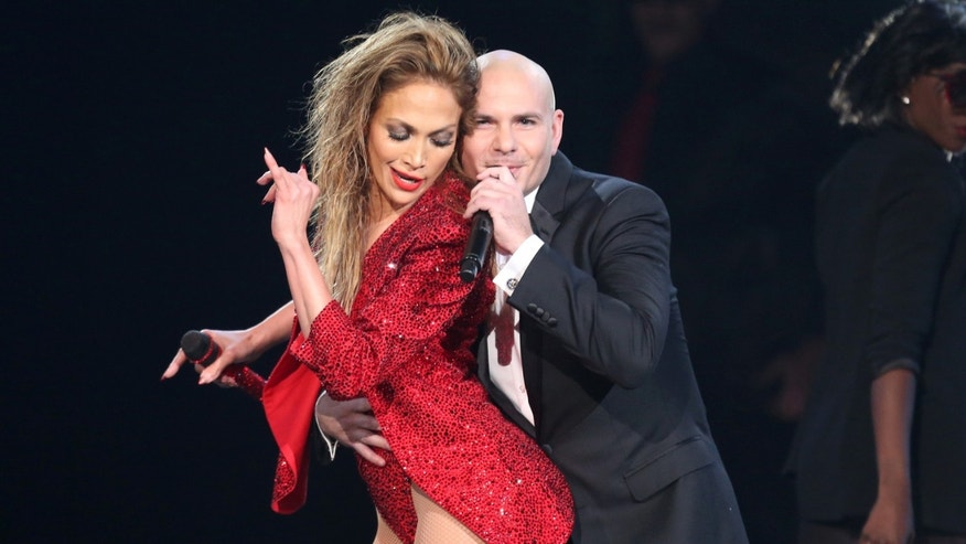 Jennifer Lopez and Pitbull at the American Music Awards in Los Angeles, on Nov. 23, 2014.