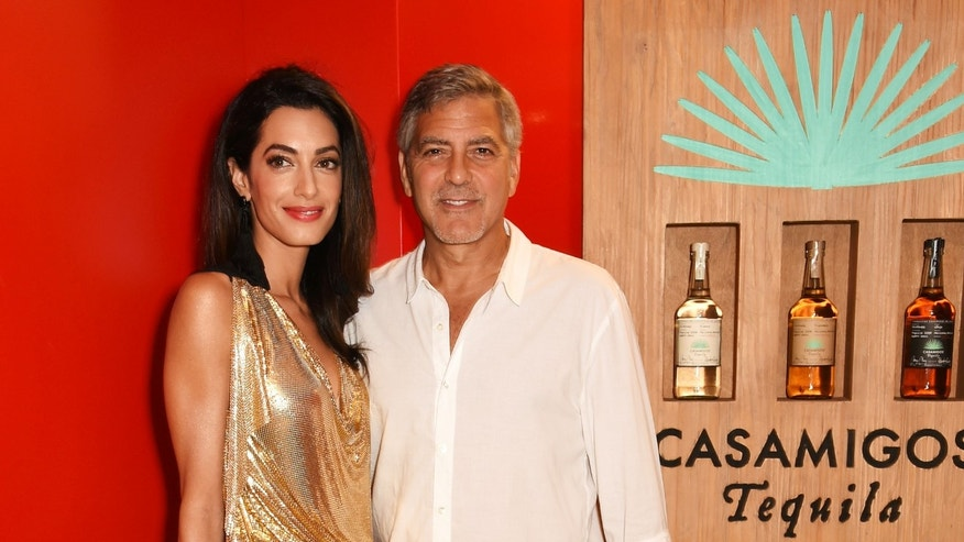 Amal and George Clooney at the official launch of Casamigos Tequila on August 23, 2015 in Ibiza, Spain.