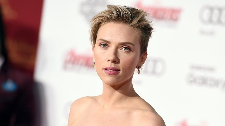 "FILE - In this April 13, 2015, file photo, Scarlett Johansson arrives at the Los Angeles premiere of ""Avengers: Age Of Ultron."" On Sept. 9, Johansson, SpaceX and Tesla Motors CEO Elon Musk and Kendrick Lamar will be the guests of Stephen Colbert CBS' ""The Late Show."" (Photo by Jordan Strauss/Invision/AP, File)"