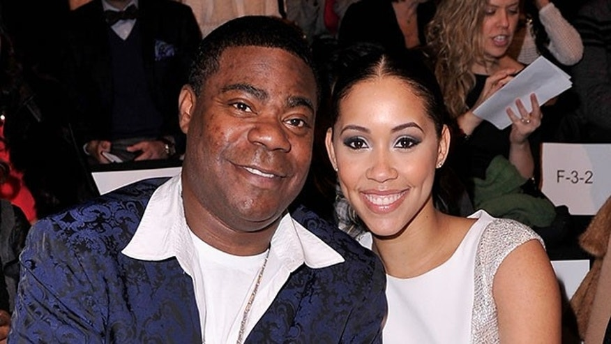 NEW YORK, NY - FEBRUARY 11:  Tracy Morgan (L) and Megan Wollover attend the Badgley Mischka fashion show during Mercedes-Benz Fashion Week Fall 2014 at The Theatre at Lincoln Center on February 11, 2014 in New York City.  (Photo by Stephen Lovekin/Getty Images for Mercedes-Benz Fashion Week)