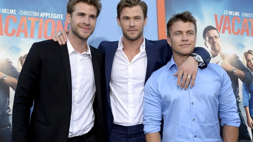 """Cast member Chris Hemsworth (C) poses with his brothers actors Liam Hemsworth (L) and Luke Hemsworth during the premiere of the film """"Vacation"""" at the Regency Village Theatre in the Westwood section of Los Angeles, California July 27, 2015."""