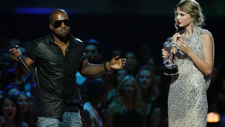 "In this Sept. 13, 2009 file photo, singer Kanye West takes the microphone from singer Taylor Swift as she accepts the ""Best Female Video"" award during the MTV Video Music Awards in New York. West ranted about how Beyonce was more deserving of the award."