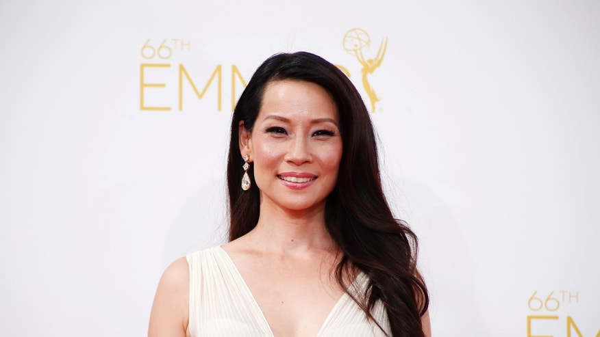 "Lucy Liu from the CBS series ""Elementary"" arrives at the 66th Primetime Emmy Awards in Los Angeles, California August 25, 2014.  REUTERS/Lucy Nicholson (UNITED STATES -Tags: ENTERTAINMENT)(EMMYS-ARRIVALS) - RTR43Q40"