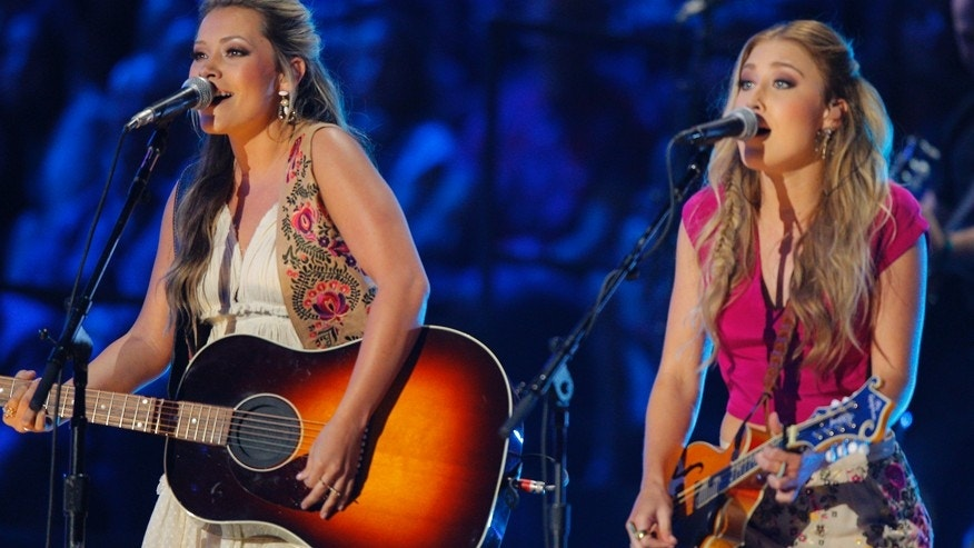 In this June 10, 2015 file photo, Tae Dye, left, and Maddie Marlow, of the musical group Maddie & Tae, perform at the CMT Music Awards in Nashville, Tenn.