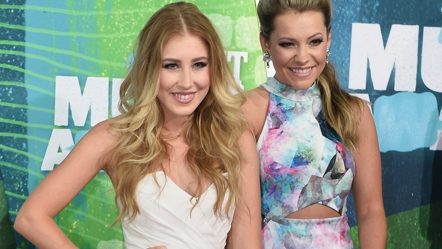 In this June 10, 2015 file photo, Tae Dye, right, and Maddie Marlow, of the musical group Maddie & Tae, arrive at the CMT Music Awards in Nashville, Tenn.