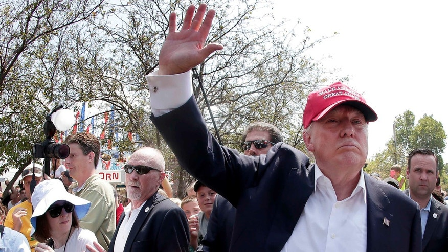 FILE - In this Saturday, Aug. 15, 2015, file photo, Republican presidential candidate Donald Trump waves to the crowd at the Iowa State Fair in Des Moines. Trump wants to deny citizenship to the babies of immigrants living in the U.S. illegally as part of an immigration plan that emphasizes border security and deportation for millions. (AP Photo/Charlie Riedel, File)