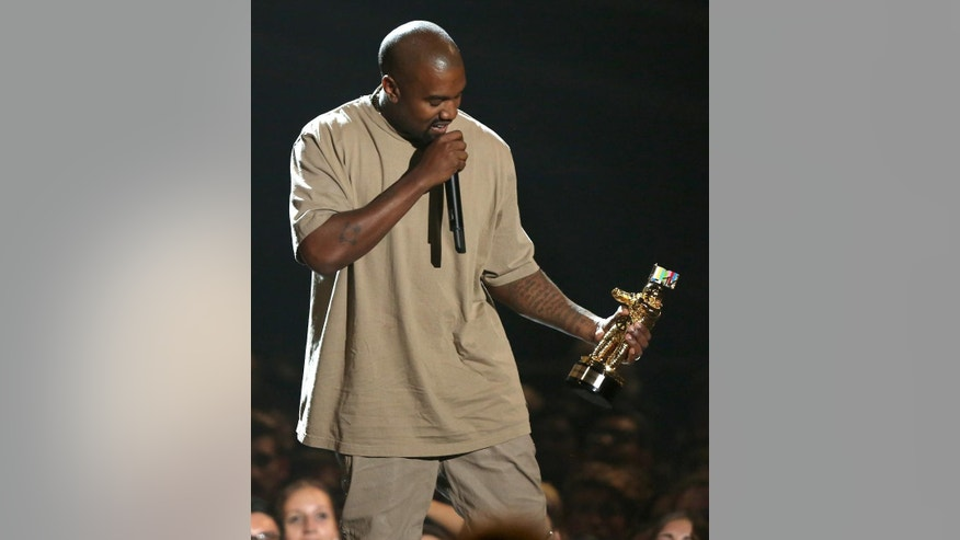 Kanye West accepts the video vanguard award at the MTV Video Music Awards at the Microsoft Theater on Sunday, Aug. 30, 2015, in Los Angeles. (Photo by Matt Sayles/Invision/AP)