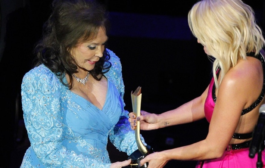 Loretta Lynn, left, accepts her award from Miranda Lambert at the 9th Annual ACM Honors at The Ryman Auditorium on Tuesday, Sept. 1, 2015 in Nashville, Tenn.