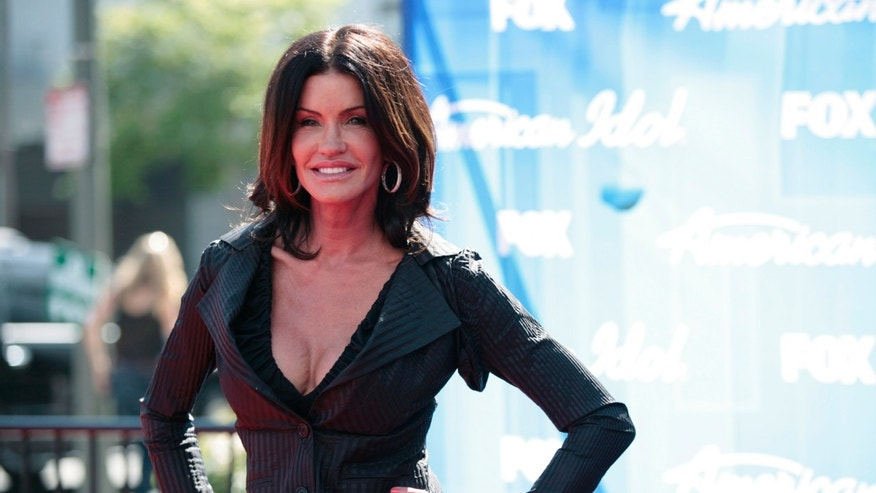 "May 23, 2012. Model Janice Dickinson poses on the red carpet during the 11th season finale of ""American Idol"" in Los Angeles."