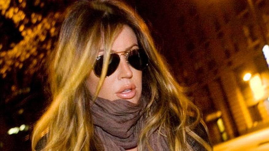Nov. 29, 2009: Rachel Uchitel gets into a car in front of her home in New York.