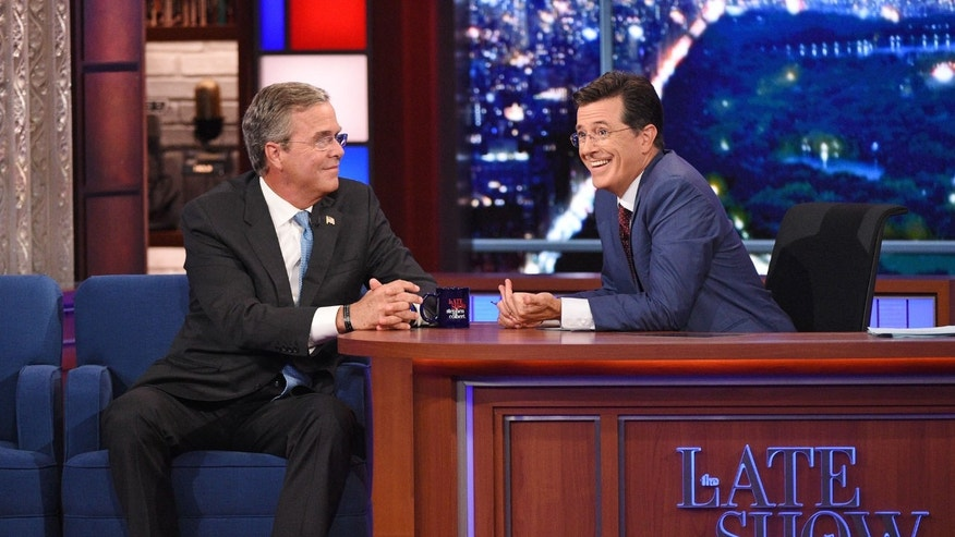 "Stephen Colbert and Jeb Bush during premiere of ""The Late Show,"" Sept. 8, 2015."