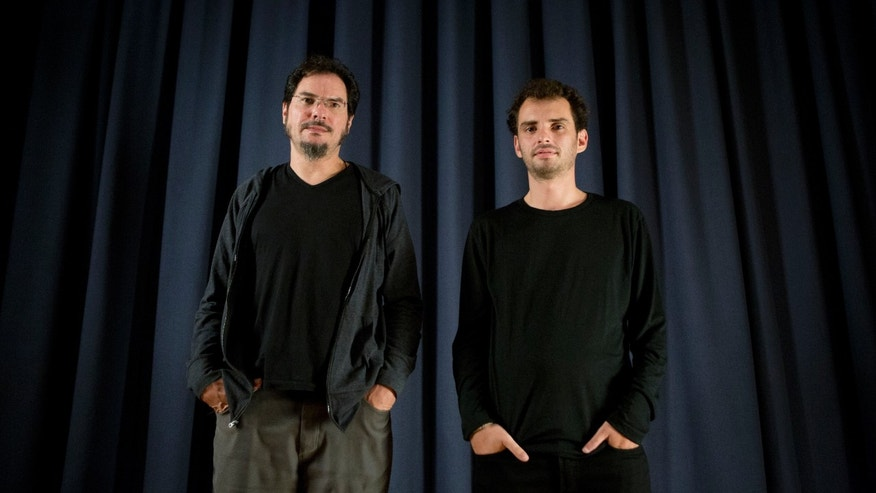 "Mexican filmmakers Jonas Cuaron, right, and his uncle Carlos Cuaron pose for portraits after an interview about their new film ""Desierto"" in Mexico City, Wednesday, Sept. 9, 2015. Jonas, who directed Desierto, is best known for co-writing the script of Gravity along with his father, celebrated director Alfonso Cuaron. Desierto stars Gael Garcia Bernal and premieres Sept. 13 at the Toronto International Film Festival. (AP Photo/Rebecca Blackwell)"