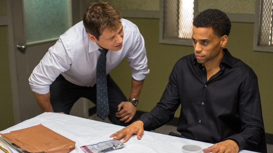 "Holt McCallany, left, as Detective Hansen, interogates Michael Ealy as Carter in ""The Perfect Guy."""