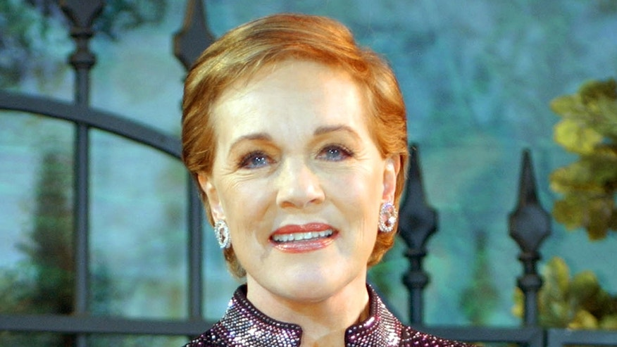 Julie Andrews pose for photographs during arrivals to the 40th anniversary and re-premiere of Mary Poppins at the El Capitan Theatre in Los Angeles, Tuesday, Nov. 30, 2004. (AP Photo/Ann Johansson)