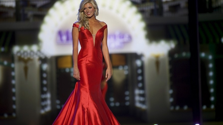 Miss Colorado Kelley Johnson competes in the evening gown competition on the first night of preliminaries at the Miss America competition at Boardwalk Hall in Atlantic City, New Jersey, September 8, 2015.