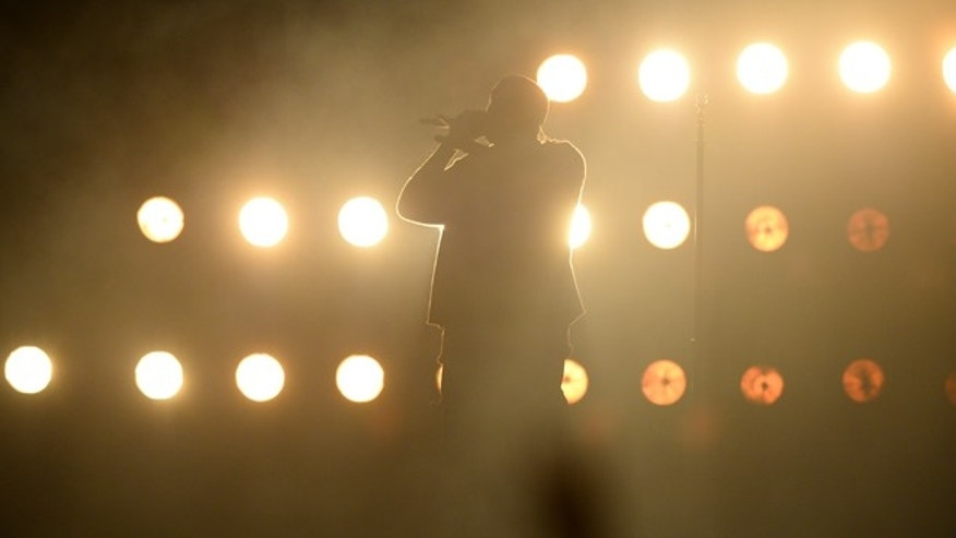 September 18, 2015. Kanye West performs at Day 1 of the 2015 iHeartRadio Music Festival at the MGM Grand Garden Arena in Las Vegas, Nevada.