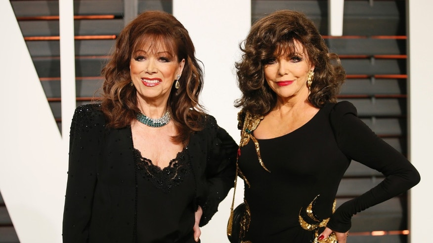 February 22, 2015. Actress Joan Collins (R) and writer Jackie Collins arrive at the 2015 Vanity Fair Oscar Party in Beverly Hills, California.