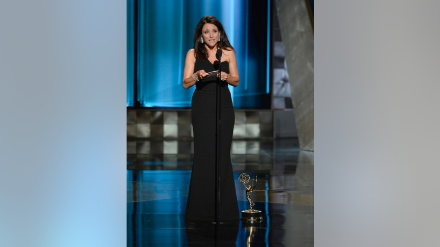 IMAGE DISTRIBUTED FOR THE TELEVISION ACADEMY - Julia Louis-Dreyfus accepts the award for outstanding lead actress in a comedy series for Veep at the 67th Primetime Emmy Awards on Sunday, Sept. 20, 2015, at the Microsoft Theater in Los Angeles. (Photo by Phil McCarten/Invision for the Television Academy/AP Images)