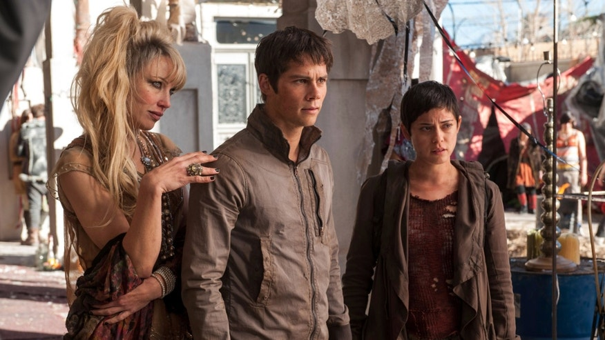 "Jenny Gabrielle, from left, Dylan OBrien and Rosa Salazar appear in a scene from the film, ""Maze Runner: The Scorch Trials."""