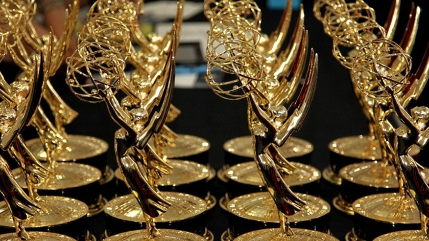 Sept. 23, 2012. Statues of the 64th Emmy awards are displayed on a table backstage at the 64th Primetime Emmy Awards at the Nokia Theatre in Los Angeles.