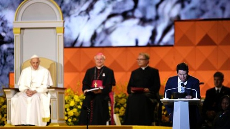 Sept. 26, 2015: Actor Mark Wahlberg speaks as Pope Francis is seated nearby during the Festival of Families in Philadelphia.