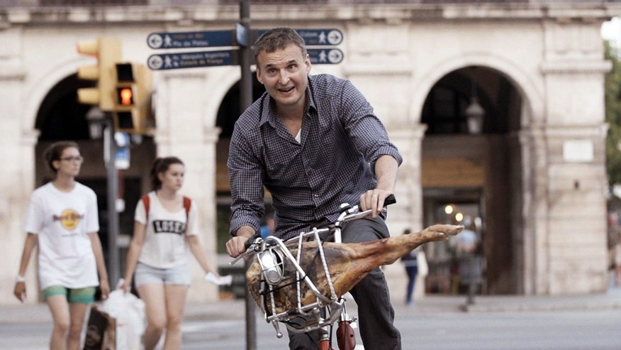 "This photo provided by courtesy of WGBH shows, Phil Rosenthal, in a scene from the food series, ""I'll Have What Phil's Having,"" in Barcelona. The show debuts Sept. 28, 2015, on PBS. (WGBH via AP)"