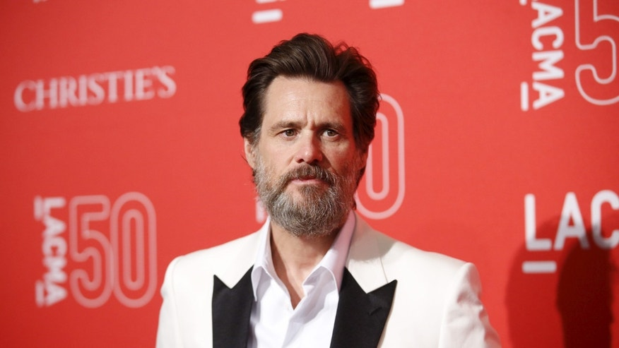 April 18, 2015. Actor Jim Carrey poses at LACMA's 50th anniversary gala in Los Angeles, California.