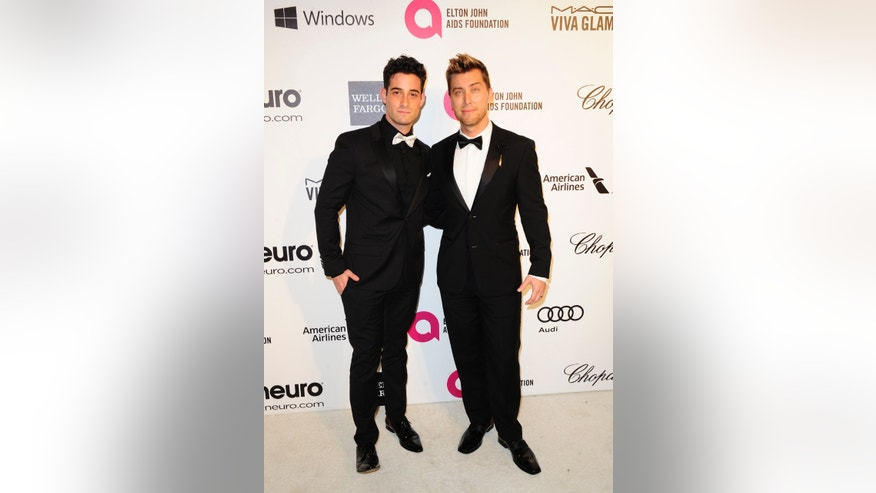 March 2, 2014. Pop singer Lance Bass (R) and Michael Turchin arrive at the 2014 Elton John AIDS Foundation Oscar Party in West Hollywood, California.