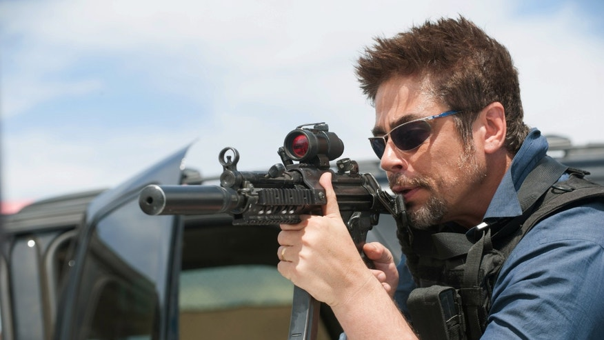 "In this image released by Lionsgate, Benicio Del Toro appears in a scene from ""Sicario."" (Richard Foreman Jr./Lionsgate via AP)"