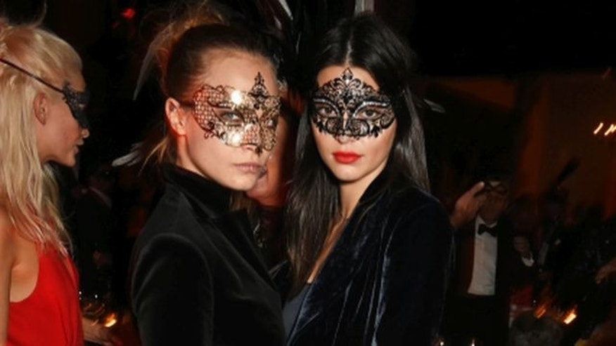 October 9, 2015.  Cara Delevingne (L) and Kendall Jenner attend Eva Cavalli's birthday party at One Mayfair in London,England.