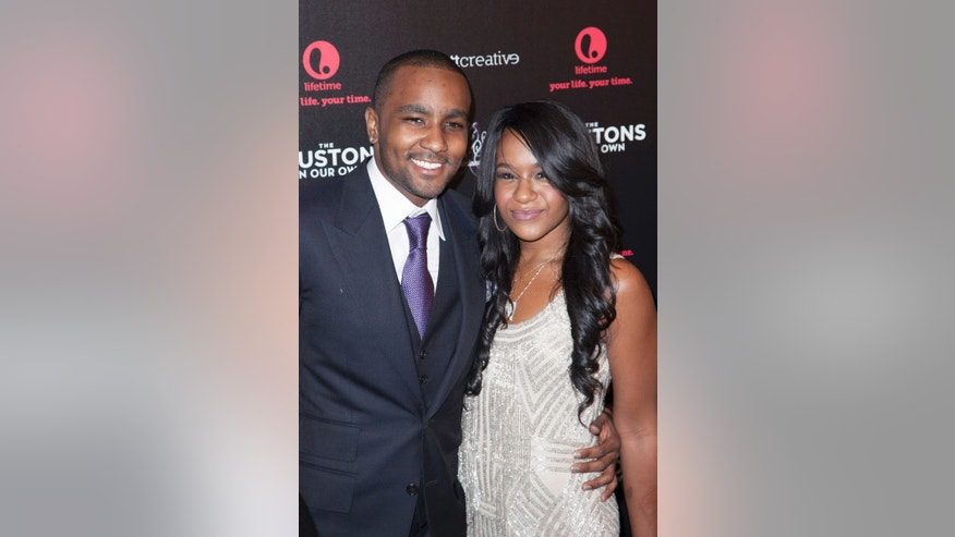 "October 22, 2012. Nick Gordon (L) and Bobbi Kristina Brown attend the opening night of ""The Houstons: On Our Own"" in New York."