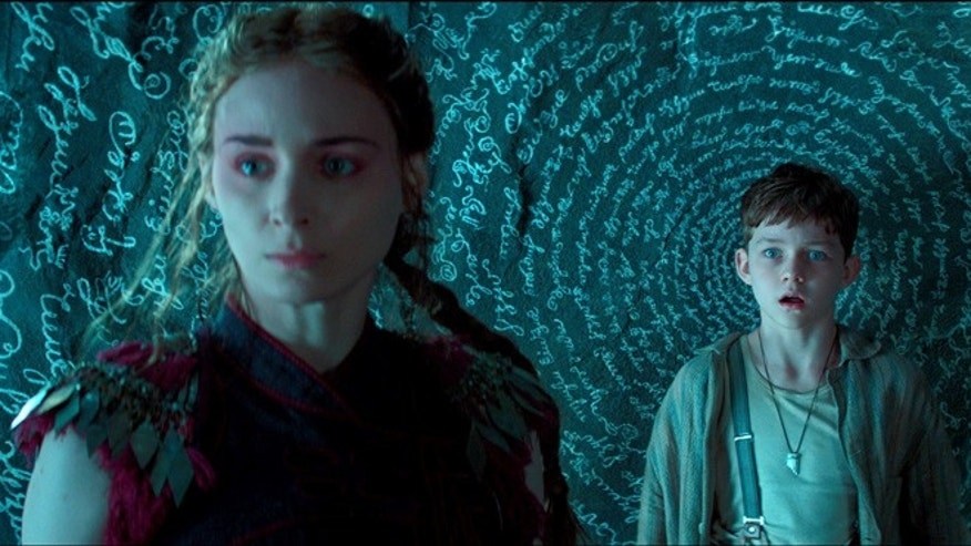 "This photo provided by courtesy of Warner Bros. Pictures shows, Rooney Mara, left, as Tiger Lily, and Levi Miller as Peter, in a scene from the film, ""Pan."""