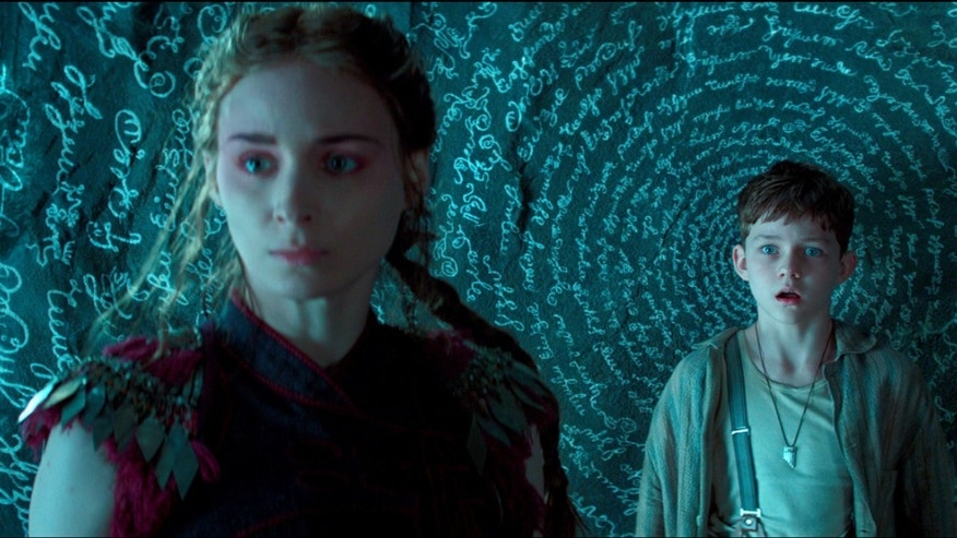 "Rooney Mara, left, as Tiger Lily, and Levi Miller as Peter, in a scene from the film ""Pan."""