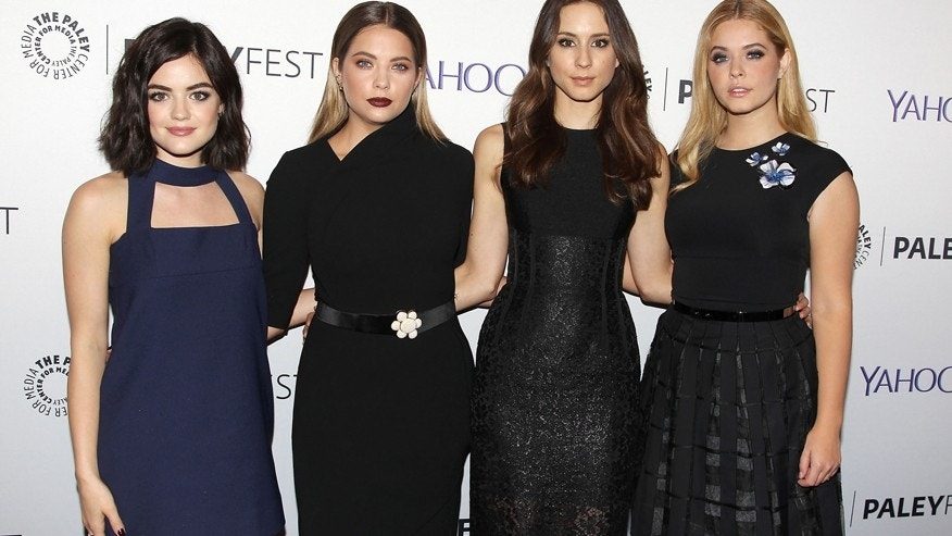 "From l-r: Lucy Hale, Ashley Benson, Troian Bellisario and Sasha Pieterse of ""Pretty Little Liars"" pose for pictures at the Paley Center for Media in New York, NY."