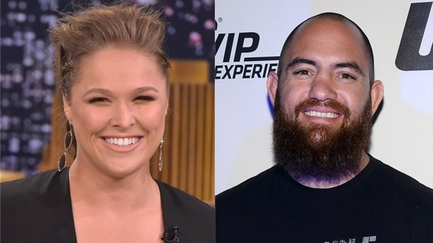 Ronda Rousey (left) and Travis Browne. (Photos: Getty Images)