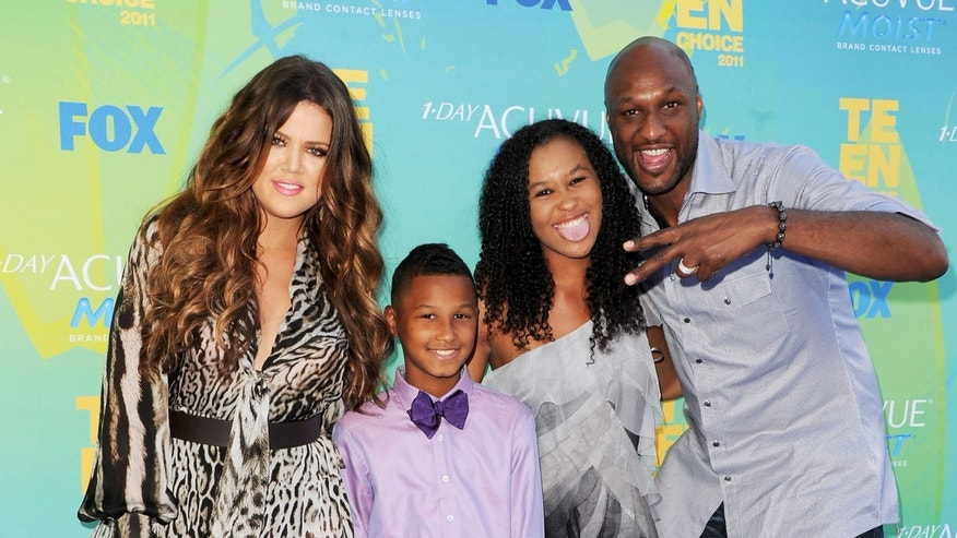 UNIVERSAL CITY, CA - AUGUST 07:  (L-R) TV personalities Khloe Kardashian, Lamar Jr., Destiny and Lamar Odom arrive at the 2011 Teen Choice Awards held at the Gibson Amphitheatre on August 7, 2011 in Universal City, California.  (Photo by Jason Merritt/Getty Images)