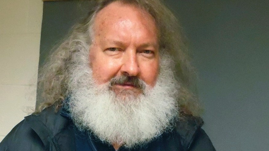 In this Oct. 9, 2015 file photo provided by the Vermont State Police, actor Randy Quaid stands in the Vermont State Police barracks in St. Albans, Vt.