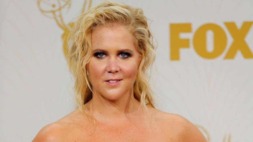 "September 20, 2015. Comedian Amy Schumer holds her award for Outstanding Variety Sketch Series for Comedy Central's ""Inside Amy Schumer"" during the 67th Primetime Emmy Awards in Los Angeles, California."