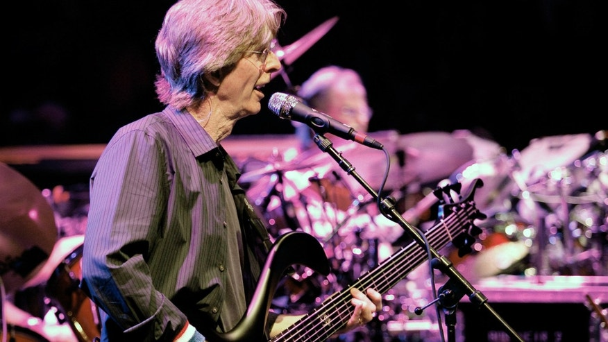 FILE - This May 9, 2009, file photo bassist Phil Lesh performs with The Dead, at the Forum in the Inglewood section of Los Angeles, Calif.