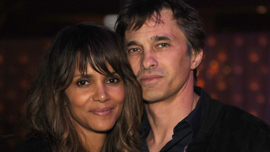 LOS ANGELES, CA - FEBRUARY 21: Halle Berry (L) and Olivier Martinez attend the Treats! Magazine Pre-Oscar Party at the Treats! Villa presented by OMNIA on February 21, 2015 in Los Angeles, California.  (Photo by Joshua Blanchard/Getty Images for Treats! Magazine)
